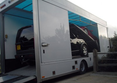 Our fully enclosed transporter can easily carry 2 large 4x4s (eg Landrover Discovery) or 2 large executive saloons.