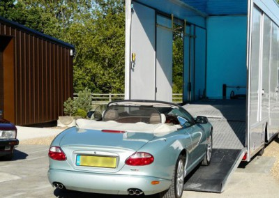 No need to put the hood up - this immaculate Jaguar XK will be fully protected from the elements in our enclosed transporter.