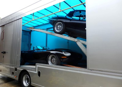 A lovely Eagle E Type together with a fabulous Eagle speedster awaiting transportation