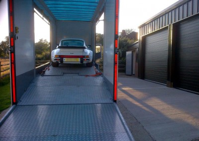 A Porsche 911 Turbo awaiting strapping loaded onto the lowered top deck of our Mercedes transporter.