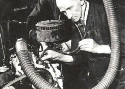 Early family photo! Grandad working at The Roots Group car factory in Coventry testing an engine. We believe the photo was probably taken some time during the 1930s.