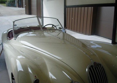 A splendid Jaguar XK140 loaded and ready to deliver to a client in France.