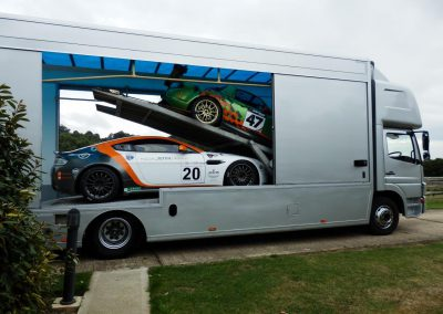 Race cars being loaded for transport